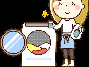 洗濯機で洗濯している主婦